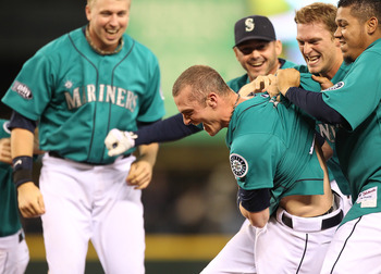 SEATTLE - MAY 06:  Brendan Ryan #26 of the Seattle Mariners is mobbed by teammates after driving in the winning run in the ninth inning to defeat the Chicago White Sox 3-2 at Safeco Field on May 6, 2011 in Seattle, Washington. (Photo by Otto Greule Jr/Get