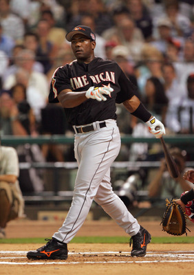 HOUSTON - JULY 12:  Miguel Tejada of the American Team follows the ball during the Major League Baseball Century 21 Home Run Derby at Minute Maid Park on July 12, 2004 in Houston, Texas. (Photo by Jed Jacobsohn/Getty Images)