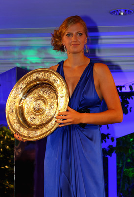 LONDON, ENGLAND - JULY 03:  Petra Kvitova of the Czech Republic holds the womens trophy at the Wimbledon Championships 2011 Winners Ball at the InterContinental Park Lane Hotel on July 3, 2011 in London, England.  (Photo by Clive Brunskill/Getty Images)