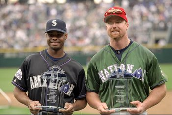6 Jul 1998:  National League member Mark McGwire #25 of the St. Louis Cardinals and American League Member Ken Griffey Jr. #24 of the Seattle Mariners accept awards for receiving the most votes in each league during the All-Star Home Run Derby at Coors Fi