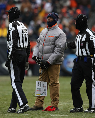 CHICAGO - DECEMBER 07: Head coach Lovie Smith of the Chicago Bears talks to referees after dropping the coaches' challenge red flag during a game between the Bears and the Jacksonville Jaguars on December 7, 2008 at Soldier Field in Chicago, Illinois. The