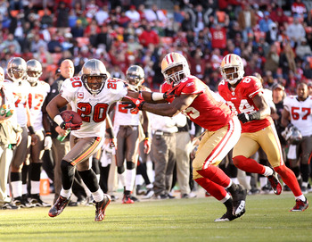 SAN FRANCISCO - NOVEMBER 21:  Ronde Barber #20 of the Tampa Bay Buccaneers returns a interception while Vernon Davis #85 of the San Francisco 49ers tries to tackled him at Candlestick Park on November 21, 2010 in San Francisco, California.  (Photo by Ezra