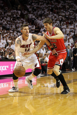 MIAMI, FL - MAY 24:  Mike Miller #13 of the Miami Heat drives against Kyle Korver #26 of the Chicago Bulls in Game Four of the Eastern Conference Finals during the 2011 NBA Playoffs on May 24, 2011 at American Airlines Arena in Miami, Florida. The Heat wo