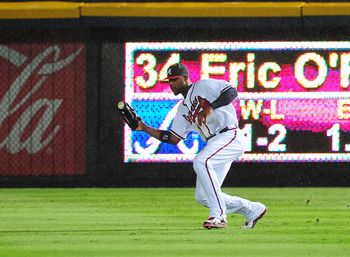 ATLANTA - JULY 2: Jason Heyward #22 of the Atlanta Braves fields a liner against the Baltimore Orioles at Turner Field on July 2, 2011 in Atlanta, Georgia. (Photo by Scott Cunningham/Getty Images)