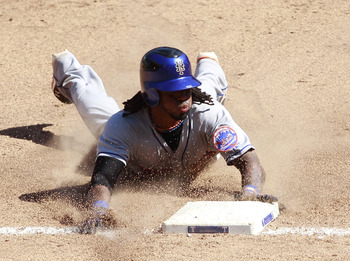 ARLINGTON, TX - JUNE 26: Jose Reyes #7 of the New York Mets slides into third base against the Texas Rangers at Rangers Ballpark in Arlington on June 26, 2011 in Arlington, Texas.  (Photo by Rick Yeatts/Getty Images)