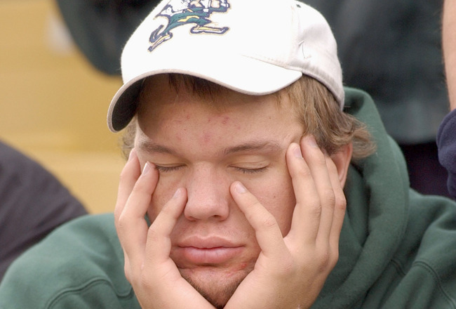 SOUTH BEND, IN - NOVEMBER 1:  A Notre Dame fan looks sleepy and disappointed as Florida State takes a commanding lead during a game on November 1, 2003 at the Notre Dame Stadium in South Bend, Indiana. (Photo by Jonathan Daniel/Getty Images)
