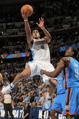 DENVER, CO - APRIL 23:  Arron Afflalo #6 of the Denver Nuggets lays up a shot over Serge Ibaka #9 of the Oklahoma City Thunder in Game Three of the Western Conference Quarterfinals in the 2011 NBA Playoffs on April 23, 2011 at the Pepsi Center in Denver,
