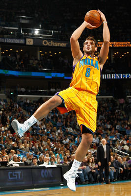 NEW ORLEANS, LA - JANUARY 22:  Marco Belinelli #8 of the New Orleans Hornets shoots the ball during the game against the San Antonio Spurs at the New Orleans Arena on January 22, 2011 in New Orleans, Louisiana.  The Hornets defeated the Spurs 96-72.  NOTE