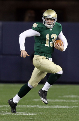 NEW YORK - NOVEMBER 20: Tommy Rees #13 of the Notre Dame Fighting Irish rushes agaisnt the Army Black Knights at Yankee Stadium on November 20, 2010 in the Bronx borough of New York City.  (Photo by Nick Laham/Getty Images)