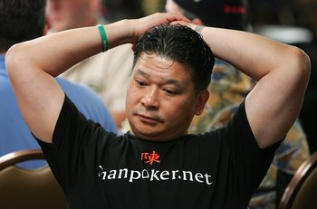 LAS VEGAS - JULY 31:  Poker legend Johnny Chan relaxes while competing on the fourth day of the first round of the World Series of Poker no-limit Texas Hold 'em main event at the Rio Hotel & Casino July 31, 2006 in Las Vegas, Nevada. More than 8,700 playe