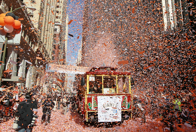 SAN FRANCISCO - NOVEMBER 03:  A cable car carrying members of the San Francisco Giants gets covered with confetti during the Giants' vicotry parade on November 3, 2010 in San Francisco, California. Thousands of Giants fans lined the streets of San Francis