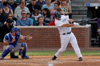 DENVER, CO - JULY 1:  Ty Wigginton #21 of the Colorado Rockies hits an RBI single to right field off of Danny Duffy #23 of the Kansas City Royals during the first inning at Coors Field on July 1, 2011 in Denver, Colorado.  (Photo by Justin Edmonds/Getty I