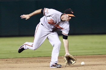 ARLINGTON, TX - JULY 5: J.J. Hardy #2 of the Baltimore Orioles catches a ground ball against the Texas Rangers at Rangers Ballpark in Arlington on July 5, 2011 in Arlington, Texas. (Photo by Rick Yeatts/Getty Images)