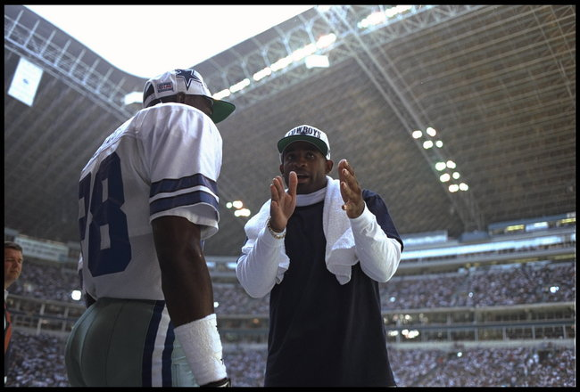 8 OCT 1995:  DALLAS CORNERBACK DEION SANDERS TALKS WITH WIDE RECEIVER MICHAEL IRVIN ON THE SIDELINE DURING THE COWBOYS 34-24 VICTORY OVER THE GREEN BAY PACKERS AT TEXAS STADIUM IN IRVING, TEXAS.  Mandatory Credit:  Al Bello/Allsport