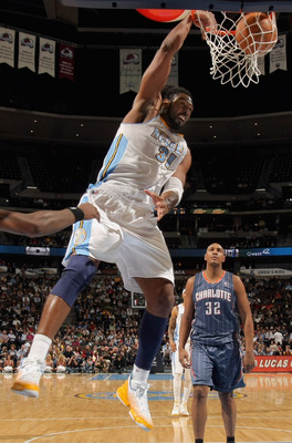DENVER, CO - MARCH 02:  Nene #31 of the Denver Nuggets dunks the ball in front of Boris Diaw #32 of the Charlotte Bobcats at the Pepsi Center on March 2, 2011 in Denver, Colorado. The Nuggets defeated the Bobcats 120-80.NOTE TO USER: User expressly acknow