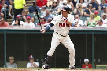 CLEVELAND, OH - JUNE 19:   Asdrubal Cabrera #13 of the Cleveland Indians bats against the Pittsburgh Pirates during their game on June 19, 2011 at Progressive Field in Cleveland, Ohio.  The Indians defeated the Pirates 5-2 in 11 innings.  (Photo by David