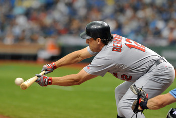 ST. PETERSBURG, FL - JULY 3:  Designated hitter Lance Berkman #12  of the St. Louis Cardinals bunts against the Tampa Bay Rays  July 3, 2011 at Tropicana Field in St. Petersburg, Florida.  (Photo by Al Messerschmidt/Getty Images)