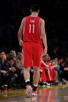 LOS ANGELES, CA - OCTOBER 26:  Yao Ming #11 of the Houston Rockets walks off the court during their opening night game against the Los Angeles Lakers at Staples Center on October 26, 2010 in Los Angeles, California. NOTE TO USER: User expressly acknowledg