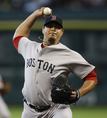 HOUSTON, TX - JULY 03:  Pitcher Josh Beckett #19 of the Boston Red Sox pitches in the first inning against the Houston Astros at Minute Maid Park on July 3, 2011 in Houston, Texas.  (Photo by Bob Levey/Getty Images)
