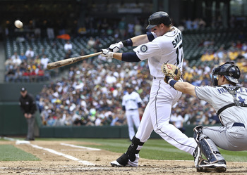 SEATTLE - JULY 03:  Justin Smoak #17 of the Seattle Mariners hits a sacrifice fly scoring Ichiro Suzuki in the third inning against the San Diego Padres at Safeco Field on July 3, 2011 in Seattle, Washington. The Mariners defeated the Padres 3-1. (Photo b