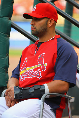 ST. LOUIS, MO - JUNE 25: An injured Albert Pujols #5 of the St. Louis Cardinals looks on from the dugout against the the Toronto Blue Jays at Busch Stadium on June 25, 2011 in St. Louis, Missouri.  (Photo by Dilip Vishwanat/Getty Images)