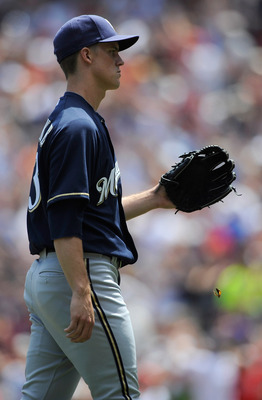 MINNEAPOLIS, MN - JULY 3: Zack Greinke #13 of the Milwaukee Brewers reacts to giving up a solo home run to Jim Thome #25 of the Minnesota Twins in the second inning on July 3, 2011 at Target Field in Minneapolis, Minnesota. (Photo by Hannah Foslien/Getty