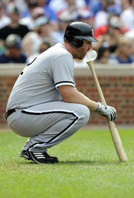 CHICAGO, IL - JULY 03: Adam Dunn # 32 of the Chicago White Sox waits to bat against the Chicago Cubs on July 3, 2011 at Wrigley Field in Chicago, Illinois. The Cubs defeated the White Sox 3-1.  (Photo by David Banks/Getty Images)