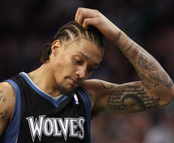 BOSTON, MA - JANUARY 03:  Michael Beasley #8 of the Minnesota Timberwolves reacts after he is called for an offensive foul in the first half against the Boston Celtics on January 3, 2011 at the TD Garden in Boston, Massachusetts. NOTE TO USER: User expres