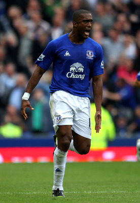 LIVERPOOL, ENGLAND - MAY 07:  Sylvain Distin of Everton celebrates scoring his team's first goal during the Barclays Premier League match between Everton and Manchester City at Goodison Park on May 7, 2011 in Liverpool, England.  (Photo by Alex Livesey/Ge