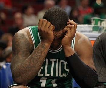 CHICAGO, IL - APRIL 07: Glen Davis #11 of the Boston Celtics reacts on the bench near the end of a loss to the Chicago Bulls at United Center on April 7, 2011 in Chicago, Illinois. The Bulls defeated the Celtics 97-81. NOTE TO USER: User expressly acknowl