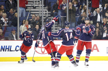 COLUMBUS, OH - MARCH 15:  Grant Clitsome #14 of the Columbus Blue Jackets is congratulated by teammates after scoring a goal against the Boston Bruins during the first period on March 15, 2011 at Nationwide Arena in Columbus, Ohio. (Photo by John Grieshop