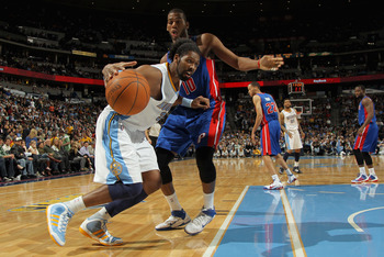 DENVER, CO - MARCH 12:  Nene #31 of the Denver Nuggets drives to the basket against the defense of Greg Monroe #10 of the Detroit Pistons at the Pepsi Center on March 12, 2011 in Denver, Colorado. The Nuggets defeated the Pistons 131-101.  NOTE TO USER: U