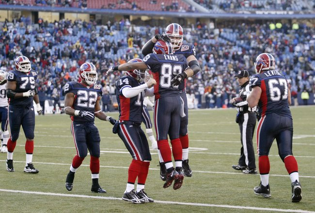ORCHARD PARK, NY - DECEMBER 20: Geoff Hangartner #63, Lee Evans #83 and Ryan Fitzpatrick #14 of the Buffalo Bills celebrate against the New England Patriots during the game at Ralph Wilson Stadium on December 20, 2009 in Orchard Park, New York. (Photo by: