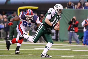 EAST RUTHERFORD, NJ - JANUARY 02: Kellen Clemens #11 of the New York Jets carries the ball against Spencer Johnson #91 of the Buffalo Bills at New Meadowlands Stadium on January 2, 2011 in East Rutherford, New Jersey. (Photo by Al Bello/Getty Images)