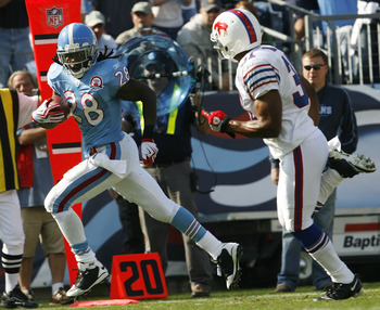 NASHVILLE, TN - NOVEMBER 15: Chris Johnson #28 of the Tennessee Titans breaks free from Jairus Byrd #31 of the Buffalo Bills for a touchdown in their NFL game at LP Field on November 15, 2009 in Nashville, Tennessee.    (Photo by John Sommers II/Getty Ima