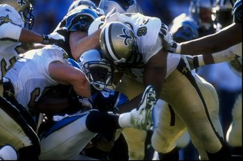 1 Nov 1998:  William Floyd #40 of the Carolina Panthers being tackled by Wayne Martin #93 during the game against the New Orleans Saints at the Ericsson Stadium in Charlotte, North Carolina. The Panthers defeated the Saints 31-17. Mandatory Credit: Vincen