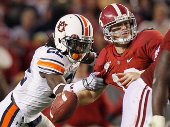 TUSCALOOSA, AL - NOVEMBER 26:  T'Sharvan Bell #22 of the Auburn Tigers sacks quarterback Greg McElroy #12 of the Alabama Crimson Tide at Bryant-Denny Stadium on November 26, 2010 in Tuscaloosa, Alabama.  McElroy was injured on this sack.  (Photo by Kevin
