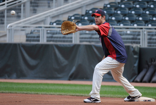 MINNEAPOLIS, MN - JUNE 27: Joe Mauer #7 of the Minnesota Twins works at first base during batting practice prior to the game against the Los Angeles Dodgers on June 27, 2011 at Target Field in Minneapolis, Minnesota. (Photo by Hannah Foslien/Getty Images)