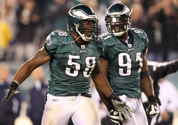 PHILADELPHIA - NOVEMBER 08:  Trent Cole #58 and Chris Clemons #91 of the Philadelphia Eagles celebrate after Cole sacked Tony Romo #9 of the Dallas Cowboys in the third quarter at Lincoln Financial Field on November 8, 2009 in Philadelphia, Pennsylvania.