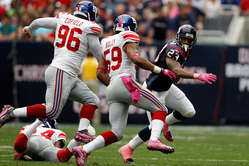 HOUSTON - OCTOBER 10:  Arian Foster #23 of the Houston Texans is chased by the New York Giants defense at Reliant Stadium on October 10, 2010 in Houston, Texas.  The Giants defeated the Texans 34-10.  (Photo by Chris Graythen/Getty Images)