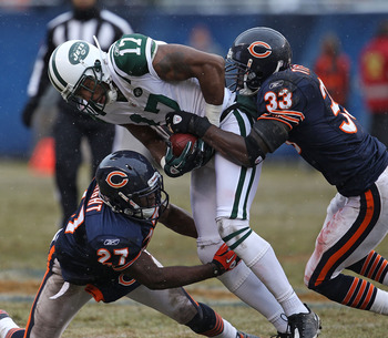 CHICAGO, IL - DECEMBER 26: Braylon Edwards #17 of the New York Jets is tackled by Major Wright #27 and Charles Tillman #33 of the Chicago Bears at Soldier Field on December 26, 2010 in Chicago, Illinois. The Bears defeated the Jets 38-34. (Photo by Jonath