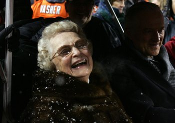 CHICAGO - JANUARY 21:  Virginia McCaskey, team owner of the Chicago Bears is seen on a golf cart with her son Michael McCaskey on the field as they await the presentation of the George S. Halas trophy against the New Orleans Saints during the NFC Champion