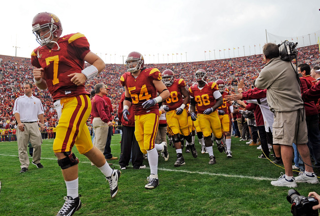 LOS ANGELES, CA - DECEMBER 05:  Matt Barkley #7 of the USC Trojans leads his team on to the field prior to the start of the NCAA college football game against the Arizona Wildcats at the Los Angeles Coliseum on December 5, 2009 in Los Angeles, California.