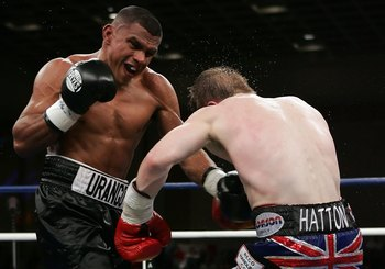 LAS VEGAS - JANUARY 20:  (L-R) Juan Urango of Colombia throws a left and knocks back Ricky Hatton of England during their junior welterweight title fight on January 20, 2007 in the Paris Ballroom at the Paris Hotel in Las Vegas, Nevada. Hatton defeated Ur