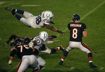 MIAMI GARDENS, FL - FEBRUARY 04:  Quaterback Rex Grossman #8 of the Chicago Bears drops back to pass as Robert Mathis #98 of the Indianapolis Colts dives in during Super Bowl XLI on February 4, 2007 at Dolphin Stadium in Miami Gardens, Florida. The Colts