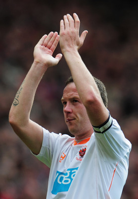 MANCHESTER, ENGLAND - MAY 22:  A dejected Charlie Adam of Blackpool applauds the fans as Blackpool are relegated after the Barclays Premier League match between Manchester United and Blackpool at Old Trafford on May 22, 2011 in Manchester, England.  (Phot