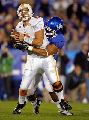 LEXINGTON, KY - NOVEMBER 28:  Jonathan Crompton #8 of the Tennessee Volunteers is sacked by DeQuin Evans #55 of the Kentucky Wildcats during the SEC game at Commonwealth Stadium on November 28, 2009 in Lexington, Kentucky.  (Photo by Andy Lyons/Getty Imag