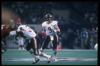 26 Jan 1986: Quarterback Jim McMahon of the Chicago Bears looks to pass the ball against the New England Patriots during Super Bowl XX at the Superdome in New Orleans, Louisiana. The Bears won the game, 46-10.