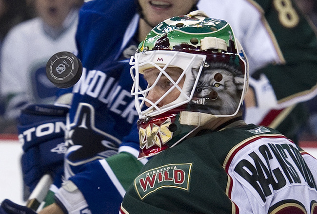 VANCOUVER, CANADA - MARCH 14: Goalie Niklas Backstrom #32 of the Minnesota Wild keeps an eye on the airborne puck after making a save against the Vancouver Canucks during the second period in NHL action on March 14, 2011 at Rogers Arena in Vancouver, Brit
