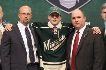 ST PAUL, MN - JUNE 24:  Tenth overall pick Jonas Brodin by the Minnesota Wild stands onstage with Head Coach Mike Yeo and a member of the Minnesota Wild organization for a photo during day one of the 2011 NHL Entry Draft at Xcel Energy Center on June 24,